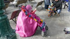 Clown doing pantomime in pram. Stock Footage