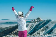 Happiness female stay on the top of mountain with beautiful view Stock Photos