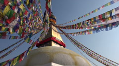 Boudhanath stupa, swaying prayer flags, landmark structure in Kathmandu, Nepal Stock Footage