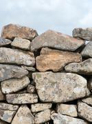 Ancient Cornish dry stone wall close up. - stock photo