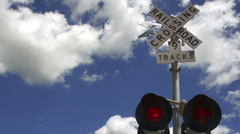 A train trips the signal while switching cars in a Texas town - stock footage