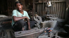 Portrait of a worker in tools manufactory in Varanasi. - stock footage