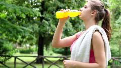UHD 4k - Woman drinking a sports drink Stock Footage