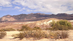 Clouds Pass Desert Floor Rugged Mountains Death Valley  Stock Footage