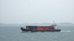 Danum 112 container ship steaming towards Singapore harbour - stock footage