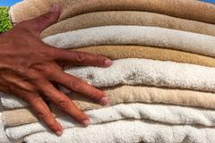 Stack of white  and broun plush hotel towels Stock Photos