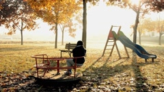 Child alone in a park Stock Footage