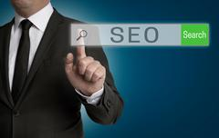 SEO internet browser is operated by businessman Stock Photos