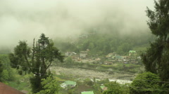 Misty fogy cloudy village in the Himalaya mountains, long shot, shallow DOF - stock footage