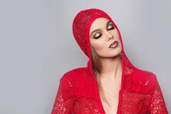 Alluring sexy woman in red knitted jacke - stock photo