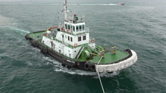 Marina Vivo tug boat guiding ship, Singapore harbour Stock Footage