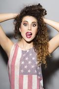Crazy girl in american flag printed shirt Stock Photos