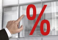 Hand pointing on percentage sign concept - stock photo