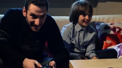 Father and son playing videogames Stock Footage