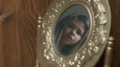 Pretty beautiful girl looks in the mirror Stock Footage