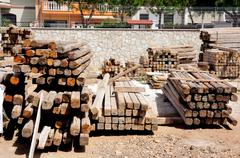 wooden beams stacked in the storage area - stock photo