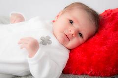 Picture of a lovely new born baby looking at the camera - stock photo