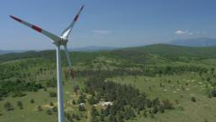 Aerial - Moving up next to the wind turbine Stock Footage