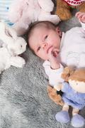 Close up of new born baby with cute expression Stock Photos