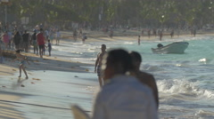 People walking and kids running on the beach in The Dominican Republic - stock footage