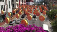 Chinese New Year decoration over road and traffic, Chinatown, Singapore Stock Footage