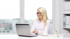 Smiling woman secretary or student with laptop Stock Footage