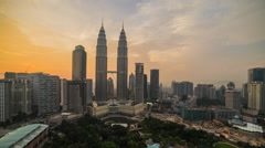 Sunset skyline of Kuala Lumpur city. Slide down timelapse. HD Stock Footage