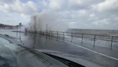 Large waves breaking over a sea wall, Colwyn Bay, North Wales coast Stock Footage