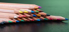 Color pencils with green background Stock Photos