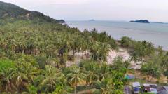 Aerial tropical island village run down Stock Footage