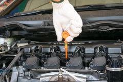 Check the oil level in engine Stock Photos