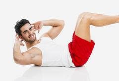 Athletic man doing ABS Stock Photos