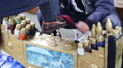 Senior shoeshine man sitting on his workplace and waiting for clients Stock Footage