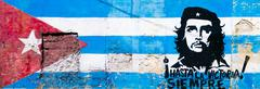 Cuban flag and Che Guevara painted on a grunge old wall in Havan Stock Photos