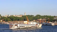 Historical Topkapi Palace and a ferry sailing into Goldenhorn Stock Footage