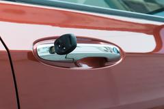 open car door with key - stock photo