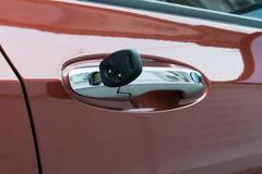 open car door with key - stock photo