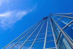 Generic skyscraper over blue sky Stock Photos
