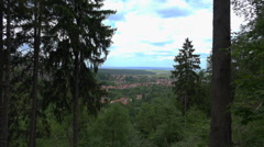 Ilsenburg village seen between trees from Harz mountain Stock Footage