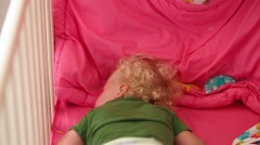 Girl sleeps on his stomach in a baby carriage. - stock footage