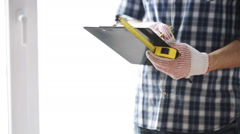 Stock Video Footage of close up of man with measuring ruler and clipboard
