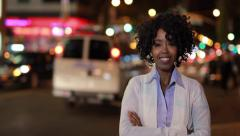 Young African American black woman in city at night smile happy face Stock Footage
