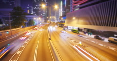 Glowing lights from moving cars at night in modern city. Overhead view  - stock footage