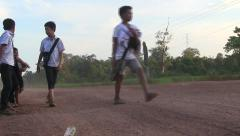 Children coming back from school on road side in Laos Stock Footage