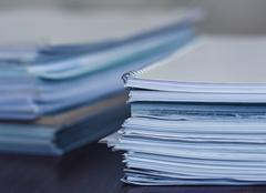 Accounting and taxes. Large pile of magazine and books Stock Photos