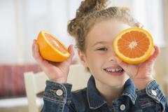 Stock Photo of Girl (10-11) holding orange