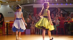 Catwalk kids models fashion show walking on a stage Stock Footage