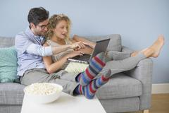 Couple watching movies on laptop Kuvituskuvat