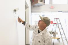 Stock Photo of Manual worker painting wall