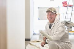 Portrait of smiling manual worker - stock photo